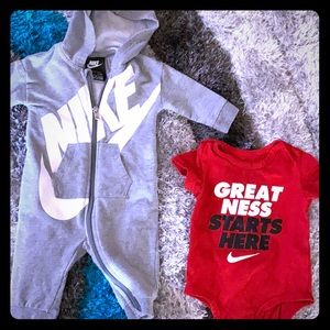 Two Nike 6 month onesie